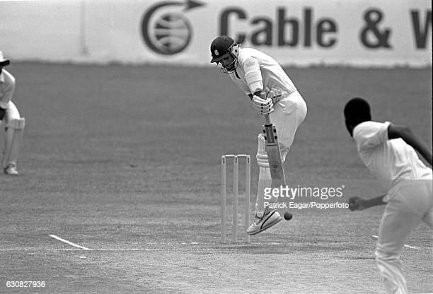 Robin Smith of England plays a delivery from West Indies bowler Courtney Walsh during the in the 5th Test match between West Indies and England at...