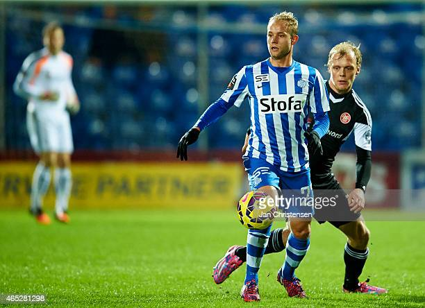 Robin Soder of Esbjerg FB $ and Kasper Pedersen of AaB Aalborg compete for the ball during the Danish DBU Pokalen Cup match between Esbjerg FB and...