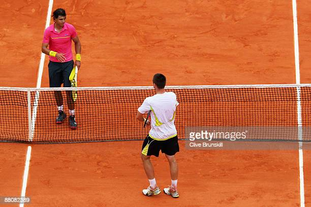 Robin Soderling of Sweden goes to shake hands with Rafael Nadal of Spain following his victory during the Men's Singles Fourth Round match on day...