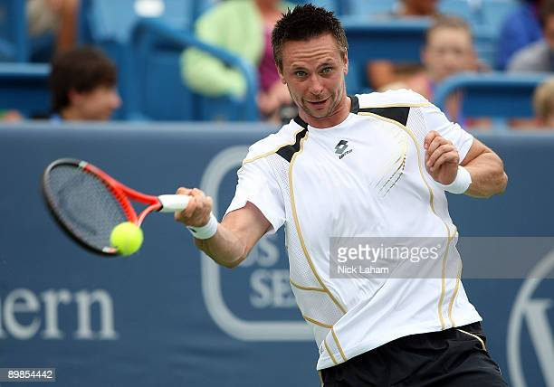 Robin Soderling of Sweden hits a forehand against Lleyton Hewitt of Australia during day two of the Western Southern Financial Group Masters on...