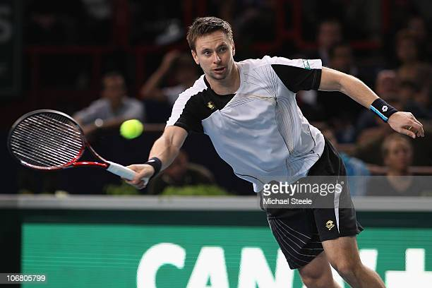 Robin Soderling of Sweden in action against Michael Llodra of France in the semi-final during Day Seven of the ATP Masters Series Paris at the Palais...