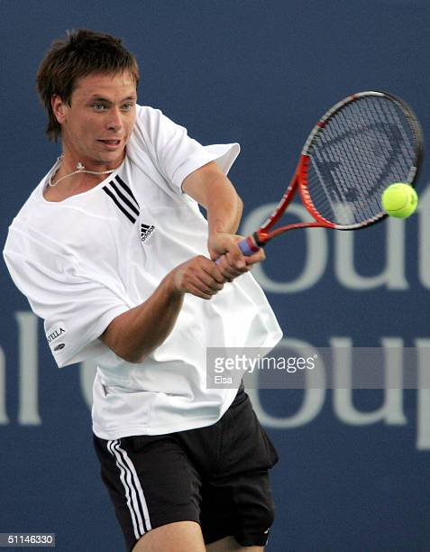 Robin Soderling of Sweden returns a shot to Tommy Haas of Germany during the Western and Southern Financial Group Masters on August 5 2004 at the...