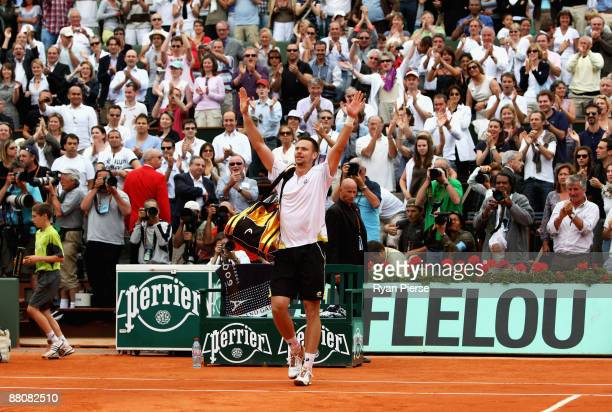 Robin Soderling of Sweden salutes the fans following his victory during the Men's Singles Fourth Round match against reigning champion Rafael Nadal...