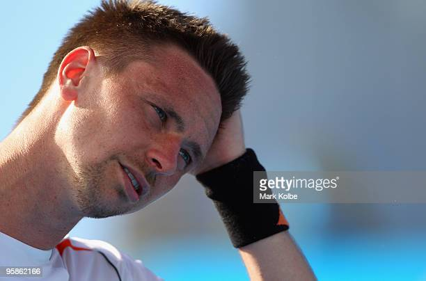 Robin Soderling of Sweden shows his emotion after losing his first round match against Marcel Granollers of Spain during day two of the 2010...
