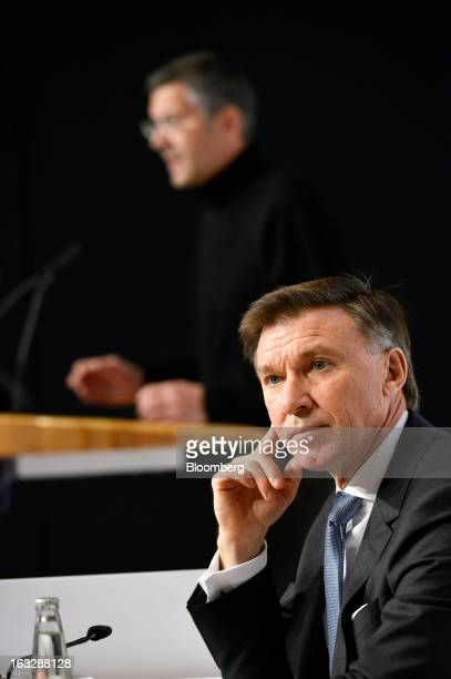 Robin Stalker chief financial officer of Adidas AG right listens as Herbert Hainer chief executive officer of Adidas AG speaks during the company's...