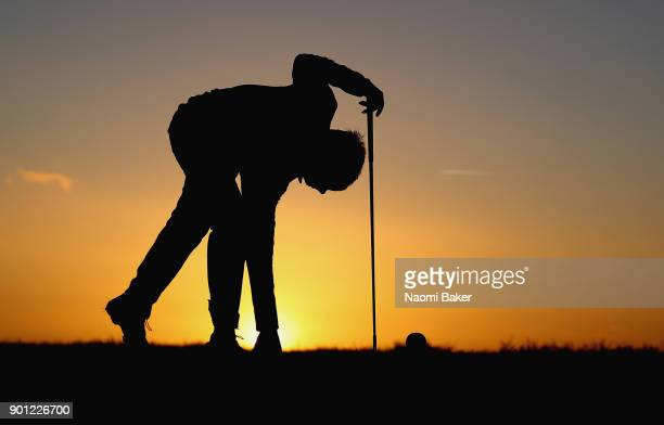 Robin Sullivan of Exeter College Oxford places his tee during the Oxford and Cambridge Golfing Society President's Putter at Rye Golf Club on January...