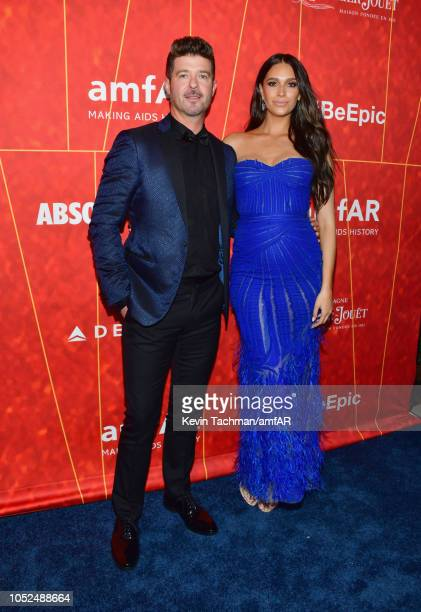 Robin Thicke and April Geary attend amfAR Los Angeles 2018 at Wallis Annenberg Center for the Performing Arts on October 18 2018 in Beverly Hills...
