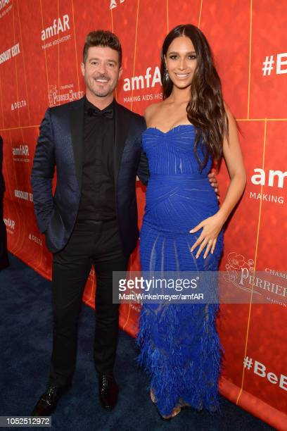 Robin Thicke and April Geary attend the amfAR Gala Los Angeles 2018 at Wallis Annenberg Center for the Performing Arts on October 18 2018 in Beverly...