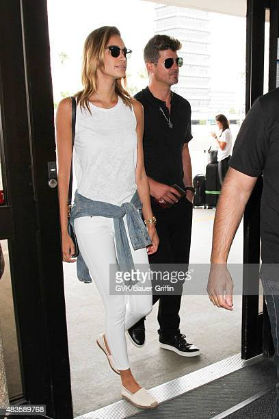 Robin Thicke and April Love Geary are seen at LAX on August 10 2015 in Los Angeles California
