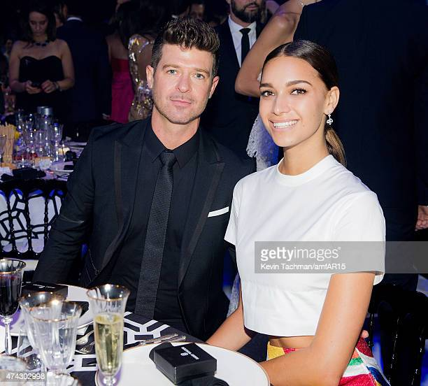 Robin Thicke and April Love Geary attend dinner for the amfAR 22nd Annual Cinema Against AIDS Gala at Hotel du CapEdenRoc on May 21 2015 in Cap...