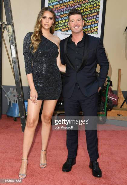 Robin Thicke and April Love Geary attend Sony Pictures' Once Upon A TimeIn Hollywood Los Angeles Premiere on July 22 2019 in Hollywood California