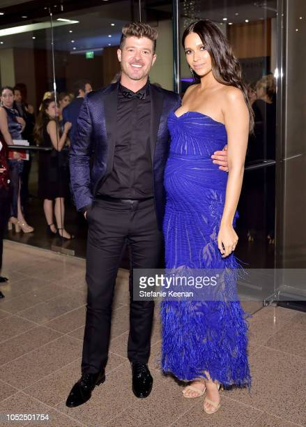 Robin Thicke and April Love Geary attend the amfAR Gala Los Angeles 2018 at Wallis Annenberg Center for the Performing Arts on October 18 2018 in...