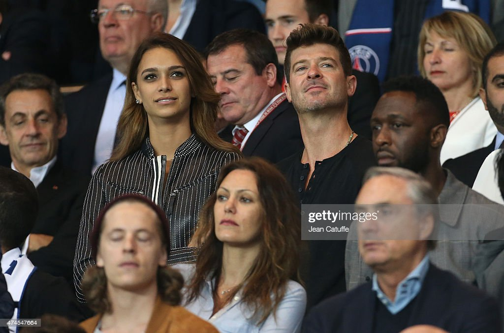 Robin Thicke and April Love Geary attend the French Ligue 1 match between Paris Saint-Germain (PSG) and Stade de Reims at Parc des Princes stadium on May 23, 2015 in Paris, France.