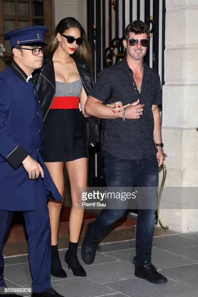 Robin Thicke and his girlfriend April Love Geary leave their hotel on September 30 2017 in Paris France