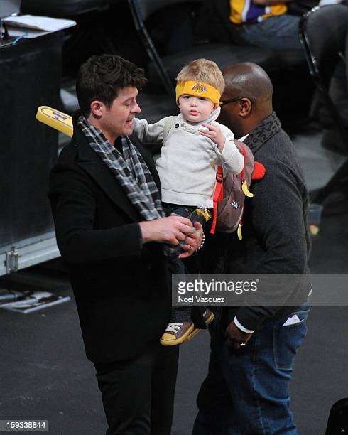 Robin Thicke and his son Julian Fuego Thicke attend a basketball game between the Oklahoma City Thunder and the Los Angeles Lakers at Staples Center...