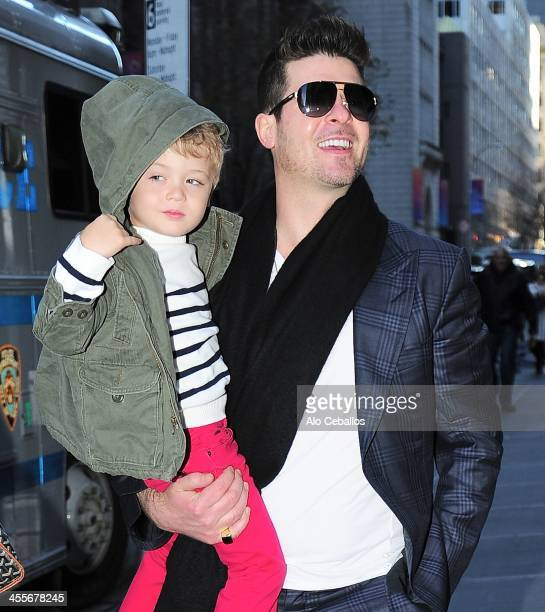 Robin Thicke and Julian Fuego Thicke are seen attending at Radio Music Hall on December 12 2013 in New York City