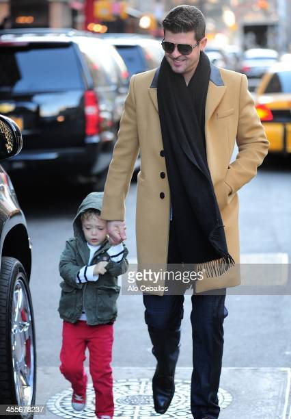 Robin Thicke and Julian Fuego Thicke are seen in Tribeca on December 12 2013 in New York City