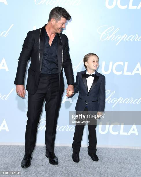 Robin Thicke and Julian Fuego Thicke arrive at the Hollywood For Science Gala at Private Residence on February 21 2019 in Los Angeles California