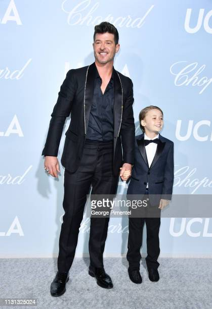 Robin Thicke and Julian Fuego Thicke arrives at the 2019 Hollywood For Science Gala at Private Residence on February 21 2019 in Los Angeles California
