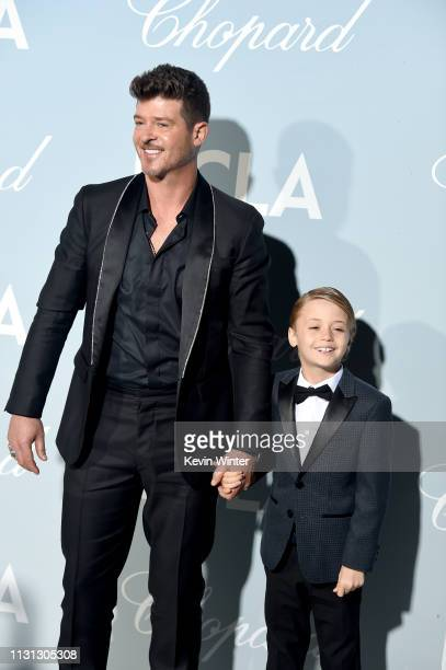 Robin Thicke and Julian Fuego Thicke attend the 2019 Hollywood For Science Gala at Private Residence on February 21 2019 in Los Angeles California