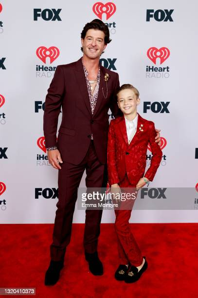 Robin Thicke and Julian Fuego Thicke attend the 2021 iHeartRadio Music Awards at The Dolby Theatre in Los Angeles, California, which was broadcast...