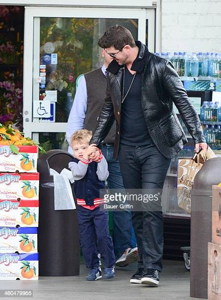 Robin Thicke and Julian Thicke are seen on January 03 2014 in Los Angeles California