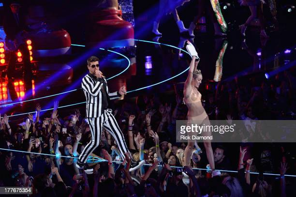 Robin Thicke and Miley Cyrus perform onstage during the 2013 MTV Video Music Awards at the Barclays Center on August 25, 2013 in the Brooklyn borough...