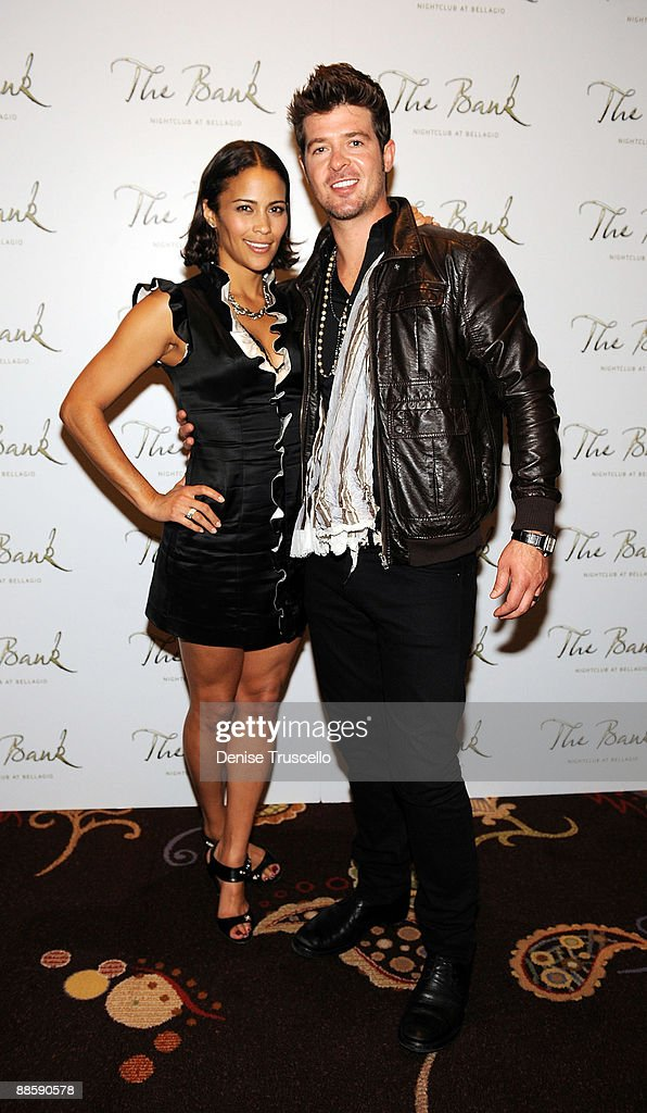 Robin Thicke (R) and Paula Patton arrive at The Bank nightclub at Bellagio Las Vegas on June 19, 2009 in Las Vegas, Nevada.
