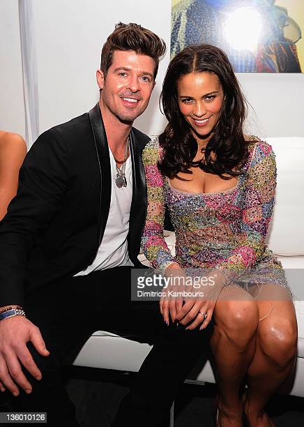Robin Thicke and Paula Patton attend the Mission Impossible Ghost Protocol US premiere after party at the Museum of Modern Art on December 19 2011 in...