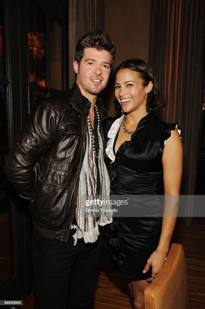 Robin Thicke (L) and Paula Patton attend Yellowtail restaurant at the Bellagio Las Vegas on June 19, 2009 in Las Vegas, Nevada.