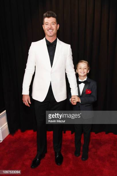 Robin Thicke and son Julian Fuego Thicke attend the 61st Annual GRAMMY Awards at Staples Center on February 10 2019 in Los Angeles California