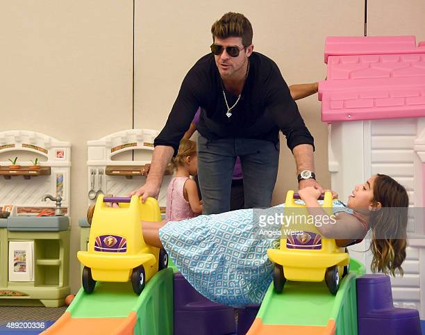 Robin Thicke attends Favoredby Presents The 4th Annual Red CARpet Safety Awareness Event at Skirball Cultural Center on September 19 2015 in Los...