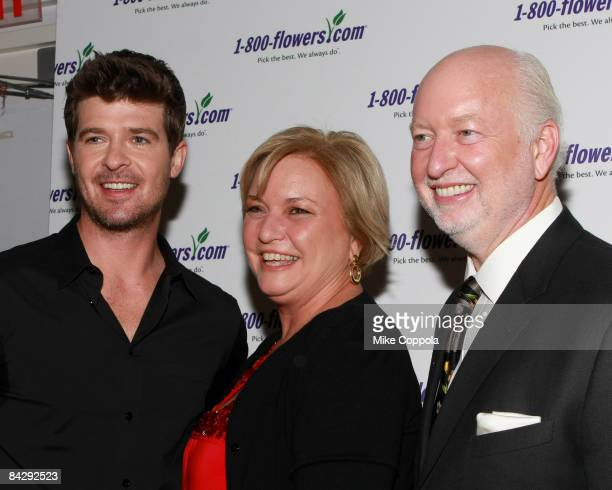 Robin Thicke Julie Mulligan and Jim McCann attends the 1800FLOWERS preValentine's bash at the Gibson Guitar showroom on January 14 2009 in New York...