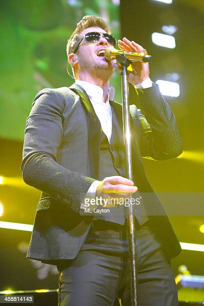 Robin Thicke performs at Hot 995's Jingle Ball 2013 at Verizon Center on December 16 2013 in Washington DC