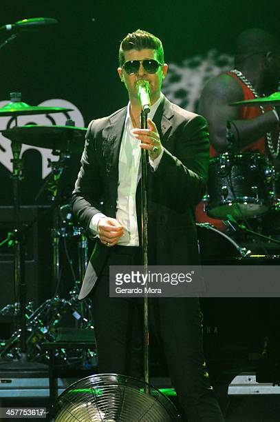 Robin Thicke performs onstage during 933 FLZ's Jingle Ball 2013 at the Tampa Bay Times Forum on December 18 2013 in Tampa Florida