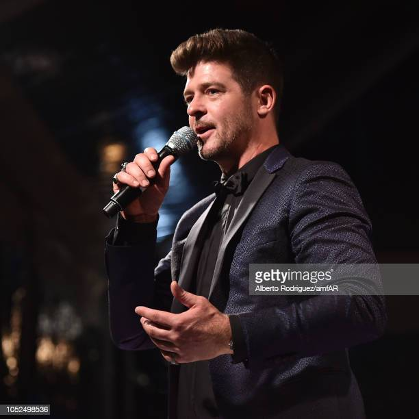 Robin Thicke speaks onstage at the amfAR Gala Los Angeles 2018 at Wallis Annenberg Center for the Performing Arts on October 18 2018 in Beverly Hills...