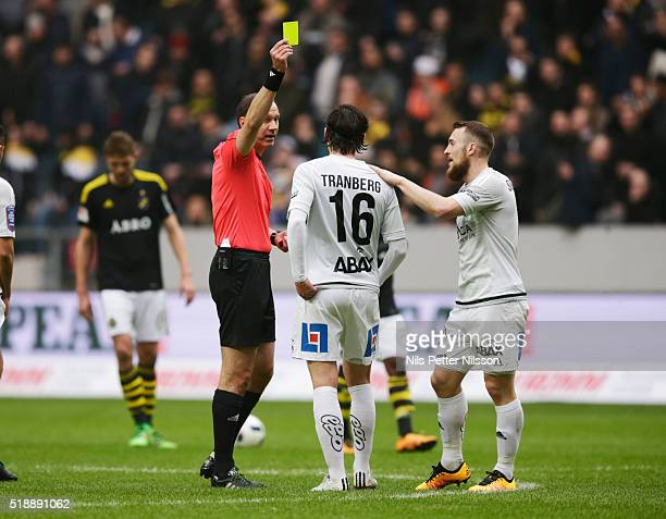 Robin Tranberg is being given a yellow card from referee Jonas Eriksson during the Allsvenskan match between AIK and GIF Sundsvall at Friends arena...