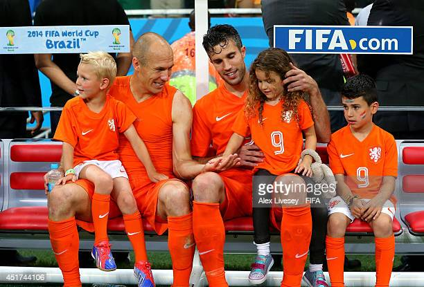 Robin van Persie and Arjen Robben of the Netherlands celebrates the win with their children after the 2014 FIFA World Cup Brazil Quarter Final match...