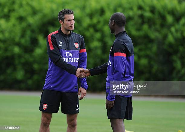 Robin van Persie and Benik Afobe of Arsenal during a training session at London Colney on July 17, 2012 in St Albans, England.