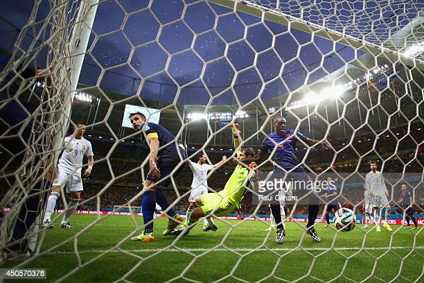 Robin van Persie and Bruno Martins Indi of the Netherlands watch as teammate Stefan de Vrij of the Netherlands scores the team's third goal against...