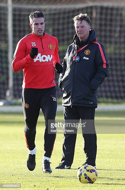 Robin van Persie and Manager Louis van Gaal of Manchester United in action during a first team training session at Aon Training Complex on December...