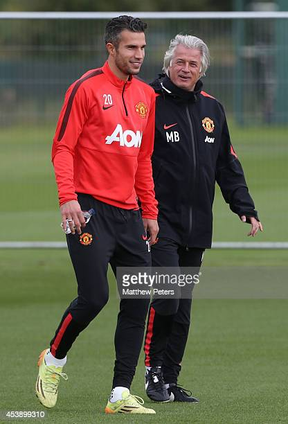Robin van Persie and Opposition coach Marcel Bout of Manchester United in action during a first team training session at Aon Training Complex on...