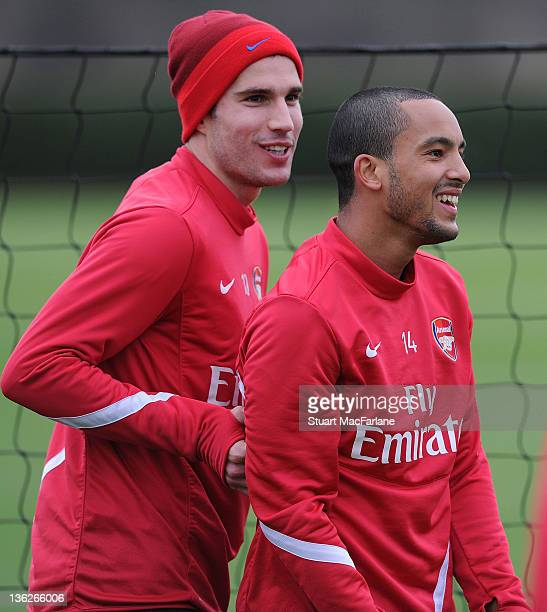 Robin van Persie and Theo Walcott of Arsenal during a training session at London Colney on December 30, 2011 in St Albans, England.