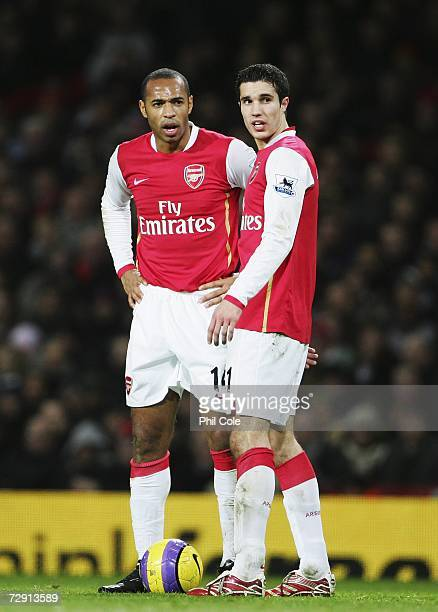 Robin van Persie and Thierry Henry of Arsenal in discussion during the Barclays Premiership match between Arsenal and Charlton Athletic at the...