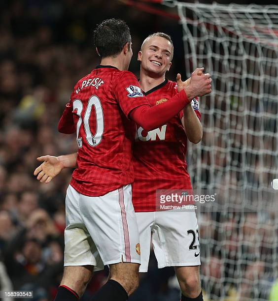Robin van Persie and Tom Cleverley of Manchester United celebrate Wayne Rooney scoring their third goal during the Barclays Premier League match...