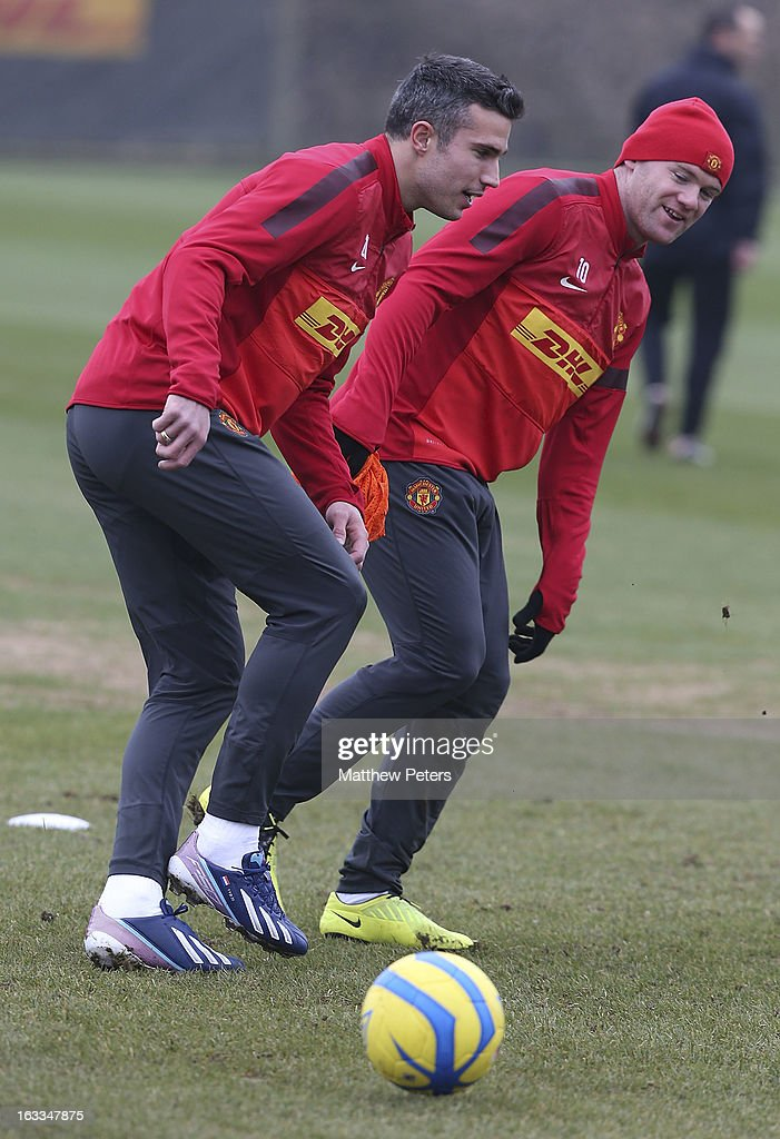 Robin van Persie (L) and Wayne Rooney of Manchester United in action during a first team training session at Carrington Training Ground on March 8, 2013 in Manchester, England.