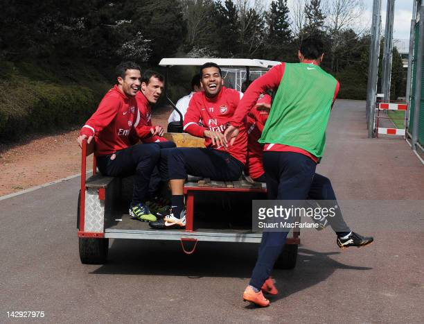 Robin van Persie, Andre Santos and Marouane Chamakh of Arsenal after a training session at London Colney on April 15, 2012 in St Albans, England.