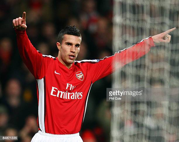 Robin Van Persie celebrates after he scores the fourth goal of the game during the FA Cup 4th Round Replay between Arsenal and Cardiff City at the...