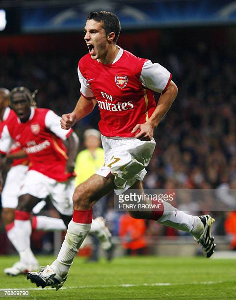 Robin Van Persie celebrates after scoring the second goal for Arsenal during a Champions League match at the Emirates Stadium in north London 19...