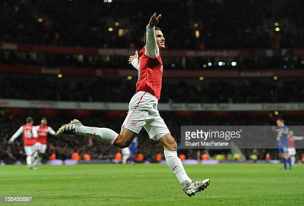 Robin van Persie celebrates scoring the 1st Arsenal goal during the Barclays Premier League match between Arsenal and Everton at Emirates Stadium on...